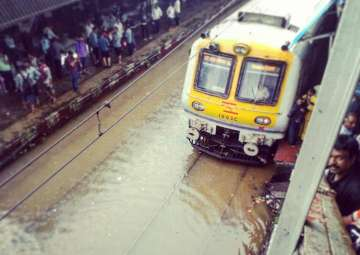 Rain fury in Mumbai: Suburban train service on...