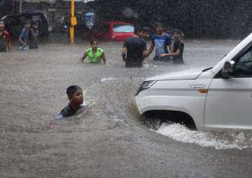 Videos: Heavy rainfall cripples normal life in...