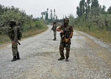 Pulwama: Army personnel stand guard during a gun...