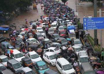 Vehicles stuck at a flooded street after heavy...