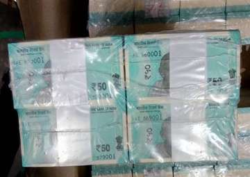 RBI to issue fluorescent blue Rs 50 note in new...
