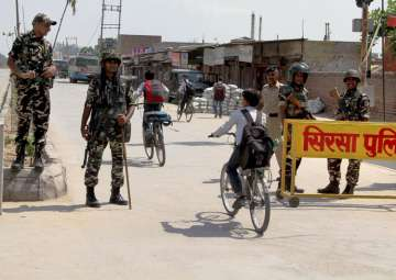 File pic - Security forces at Satnam Chowk, the...