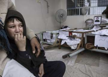 File - A Pak boy, whose brother was killed in...