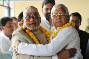 RJD MP Mohammad Taslimuddin with party chief Lalu...