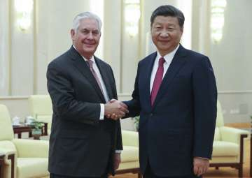 Rex Tillerson shakes hands with Xi Jinping at the...