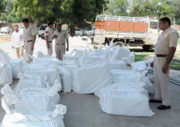 Sirsa: Police with recovered cartons of...