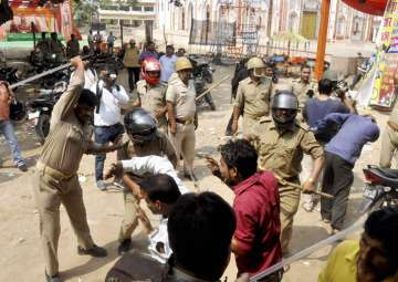 Police lathi-charge during a clash between two...