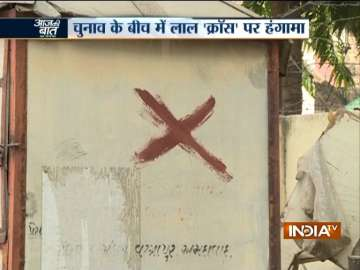 Amid election fever in Gujarat, red 'cross marks'...