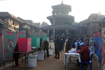 Nepalese people cast their vote during the...