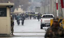 Security forces inspect the site of a suicide bombing in
