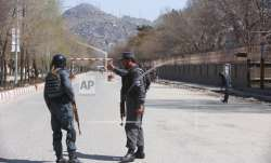 Police patrol the streets after a suicide attack in front