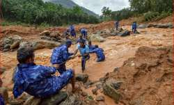 Rescue workers search for the bodies of missing persons