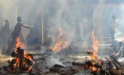 The 36 bodies were cremated in batches at a ground near