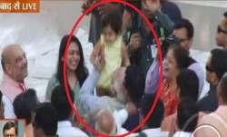 PM Narendra Modi embraces a child