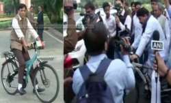 MPs ride bicycles, wear masks, drive e-cars to reach Parliament for Winter Session