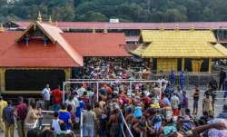 Devotees brave rain to offer prayers at Sabarimala
