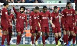 Liverpool's Mohamed Salah, 3rd left, celebrates with