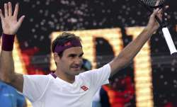 Switzerland's Roger Federer reacts after defeating Tennys