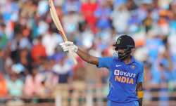 India's Lokesh Rahul looks upwards as he celebrates after