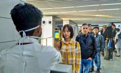 A thermal screeening device checks passengers arriving in