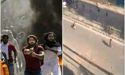 Northeast Delhi boils: Man brandishes pistol during clash