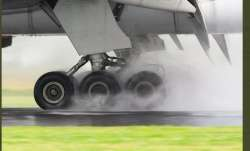 B777 plane had to abort the landing seconds after touchdown after it was caught in strong winds brou