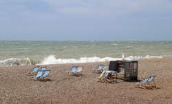 A partial view of a near empty beach with deckchairs as the hot weather cools following scenes of pe
