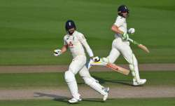 Chris Woakes and Jos Buttler of England run during Day Four