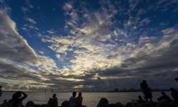 People gather at sea-side in Mumbai for a moment to relax. In the backdrop is the Bandra-Worli sea l