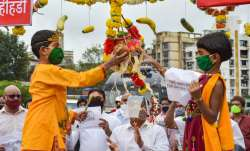 Youngsters dressed as Lord Krishna break an earthen pot on the occasion of Janmashtami (Dahi Handi),