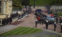 Members of the Royal family follow the coffin of Britain's
