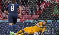 Finland's goalkeeper Lukas Hradecky makes a save during the