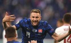Slovakia's Milan Skriniar celebrates after scoring his