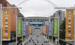 People walk the road to Wembley stadium during the Euro