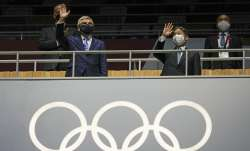President of the IOC Thomas Bach, left, and Japan's Emperor