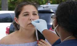 FILE | Raquel Heres gets a COVID-19 rapid test to be able