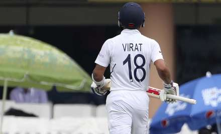 India's captain Virat Kohli leaves the field after being