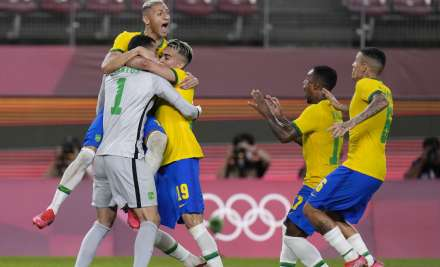 Brazil's players celebrate after defeating Mexico in a
