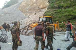 Army personnel at the site where a boulder rolled down and
